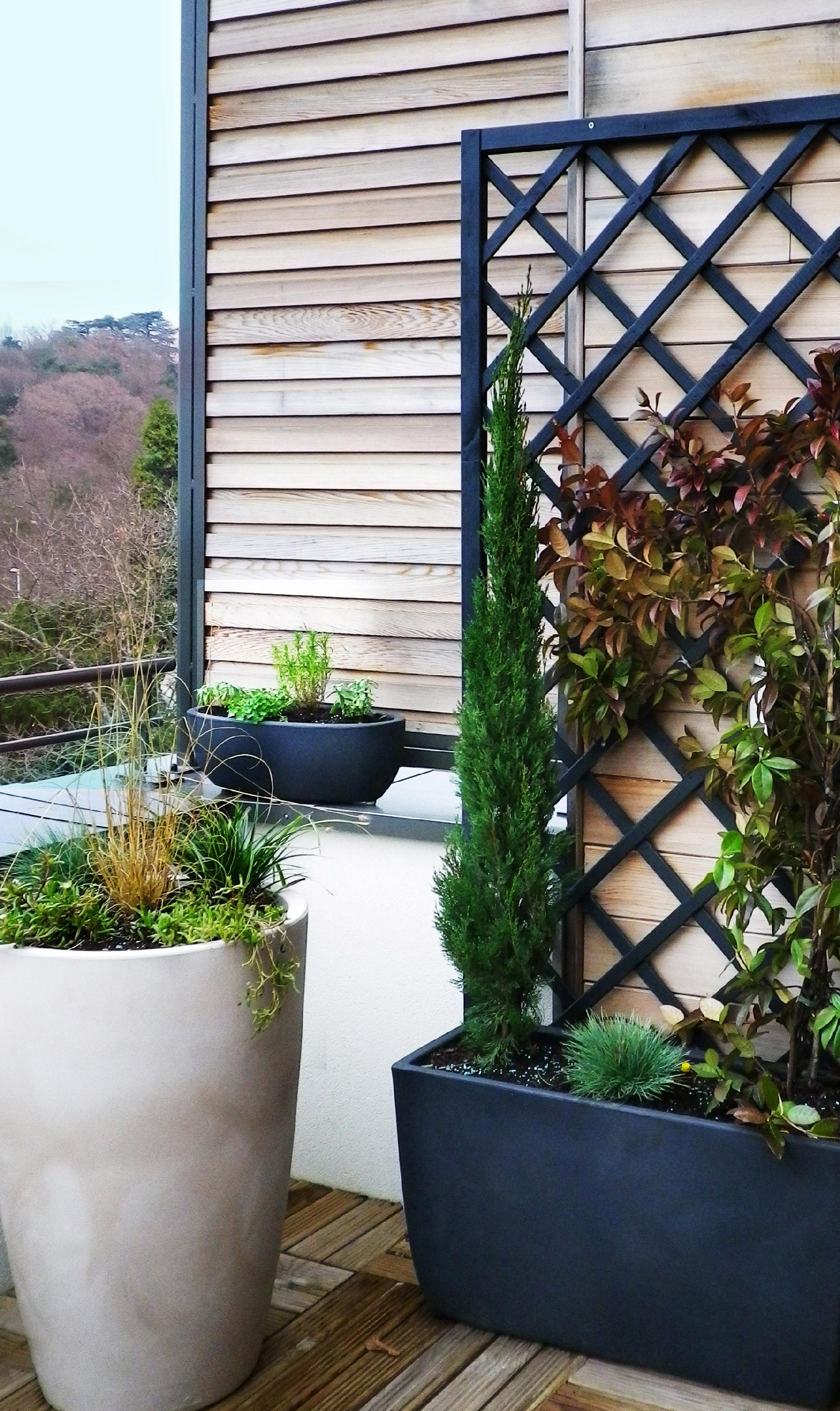 Réalisation Vert printemps. Une terrasse à l'abris des regards.